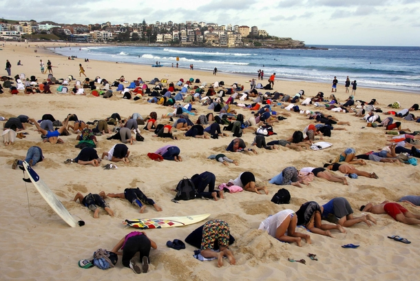 protesters In Australia mocking the governments reluctance to put climate change on the agenda of a G summit