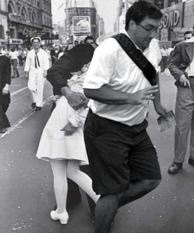 sailor kissing a woman in times square after hearing japan