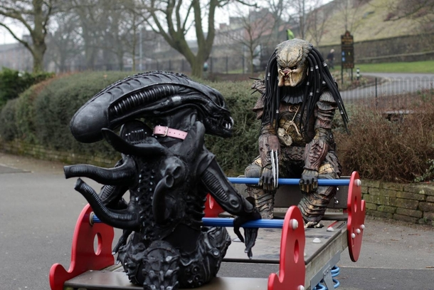 A Xenomorph from Alien and a Predator Frolicking together blissfully
