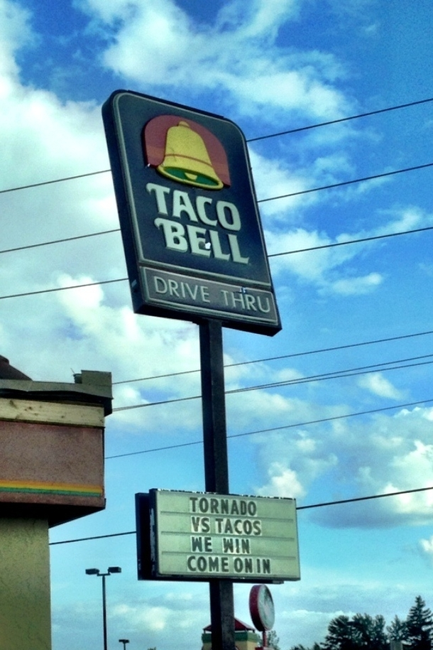 after a local taco bell was hit by a tornado they decided a broken sign and some roof damage was no 34583 after a local taco bell was hit by a tornado they decided a broken