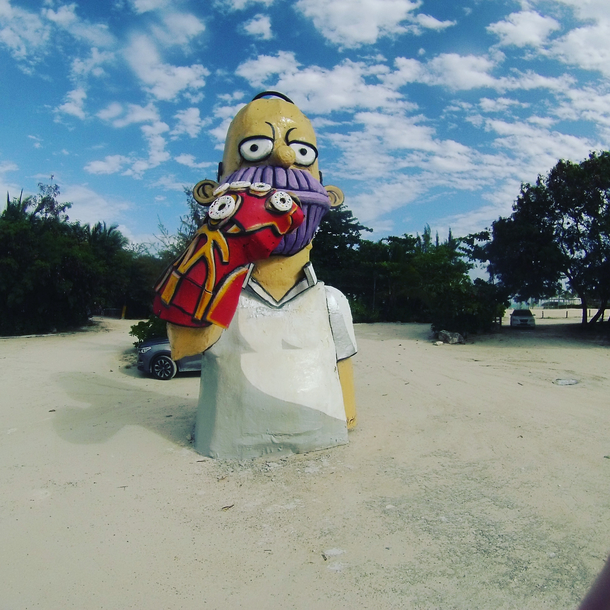 Came across this Homer Thanos wielding McDonalds fries sleeve gauntlet with five donut infinity stones found in Dominican Republic today