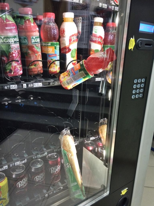 Got a sandwich stuck in vending machine Bought a drink to push the sandwich Damn