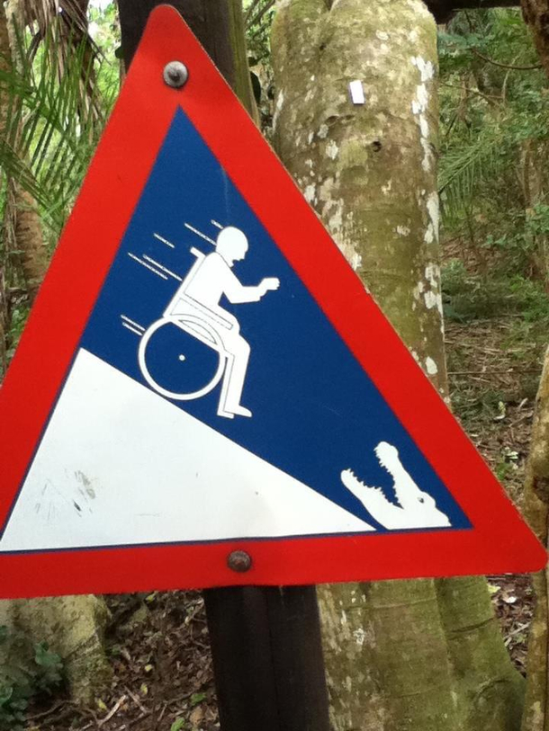 I found this sign in South Africa Yeah maybe it is not a good idea to push a person on a wheelchair towards crocodile on a hill