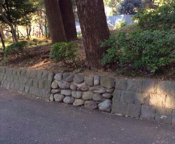 In a video game there would definitely be something hidden behind this wall