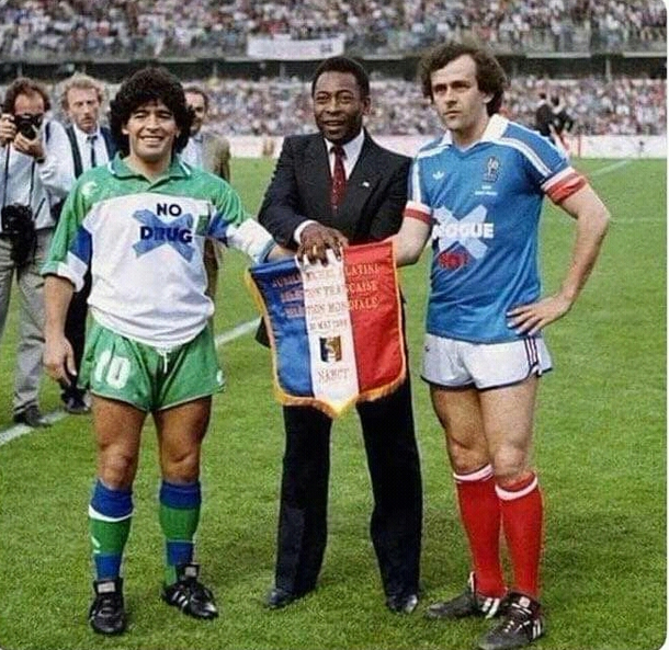 It is year  Maradona is wearing no drugs shirt Platini is wearing no corruption Time flies
