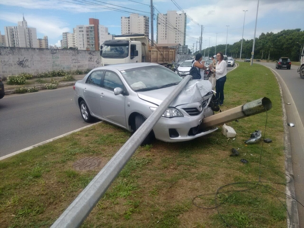 Ive seen a lot on this life but never a smoking Corolla using a selfie stick