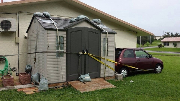 Japan typhoon-secure the car to the shed and secure the shed