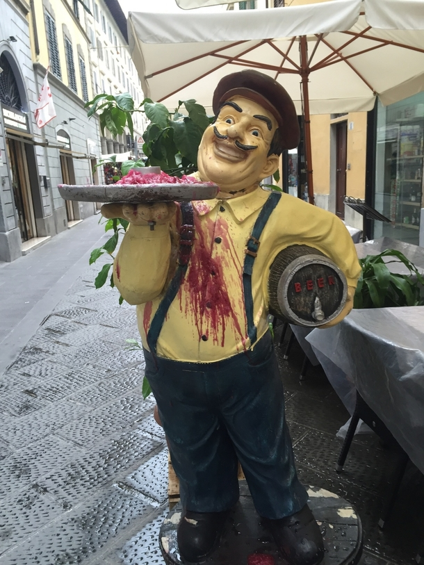 Melted candle wax makes this statue look like a murderer