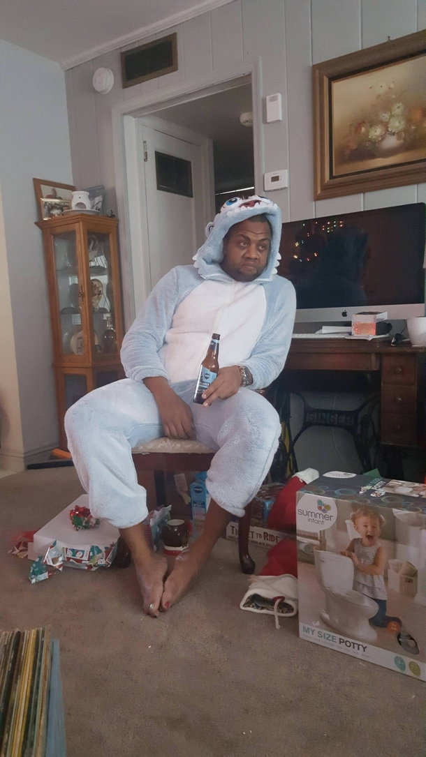 My brother-in-law who has  girls taking in the aftermath of Christmas morning wearing a Yeti Onesie that they picked out for him