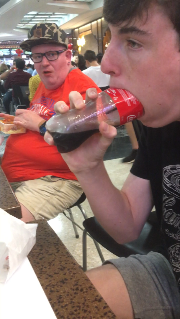 My friend deepthroating a coke bottle in public