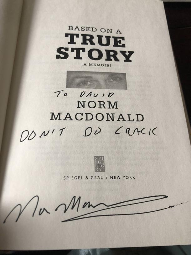 My girlfriend got Norm Macdonald to write an inscription ...
