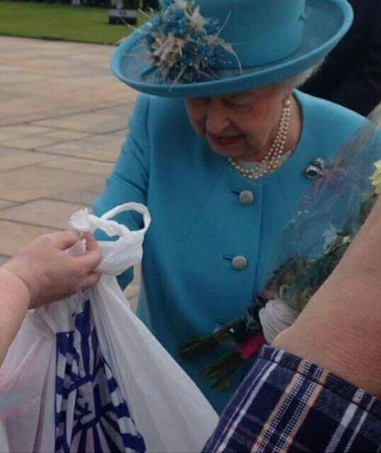 Old Glaswegian woman handing the queen a bag of toys from BampM saying Theyre for wee george