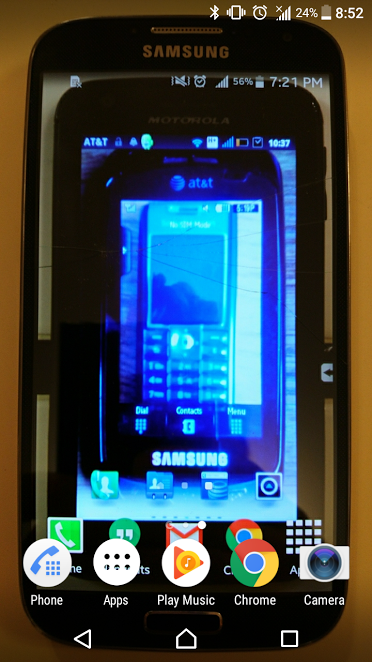 Phoneception - Whenever I upgrade my phone I snap a pic of the old phone with this photo as the background I find it pretty amusing but my wife hates it