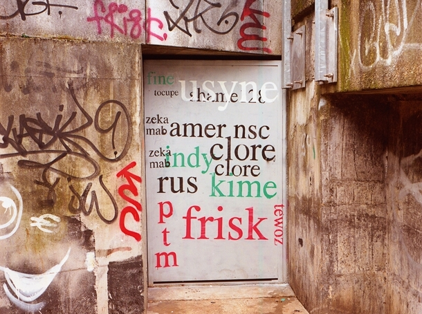 Pic #10 - Guy paints over graffiti with a more legible font