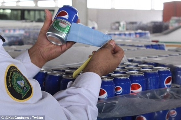 Pic #2 - CAN-ouflage Smuggler caught trying to sneak  cans of beer into Saudi Arabia by disguising them as PEPSI