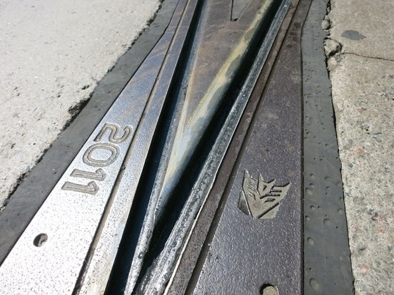So some joker carved symbols like this to Helsinki tram rails