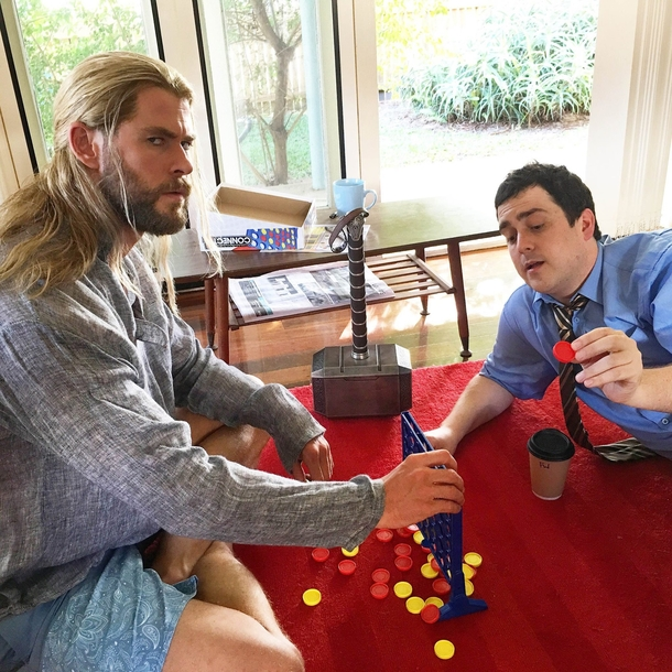 Thor on the Floor playing Connect Four - Meme Guy