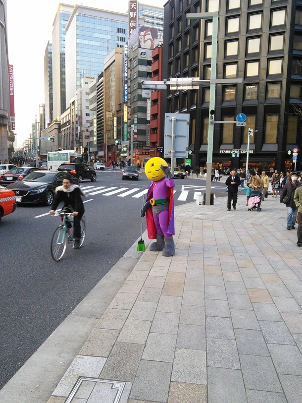 Today I met Mangetsu Man Full Moon Man a superhero from Tokyo Japan He keeps the streets clean literally