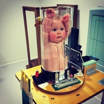 A baby getting an X-Ray looks hilarious