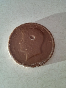 A bubble formed and popped on my chocolate coin featuring Kennedy