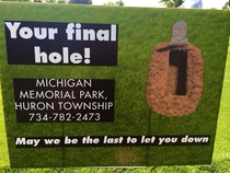 A cemetery sponsored the th hole at this golf outing