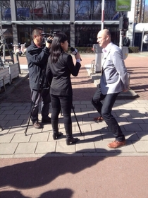 A Dutch employee gets interviewed by Chinese media