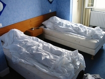 A few years ago a friend and I made false corpses with sheets before leaving our hotel