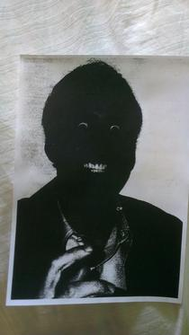 A friends printer broke heres the result of him printing off a picture of Nicolas Cage