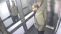 A would-be thief has been caught on camera apparently trying to make off with a Venetian blind - by stuffing it down one trouser leg and up his jacket