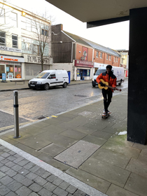 am nearly on a dreary Monday morning in Swansea and this kid passed playing the guitar on his wheelie-board Spreading that joy like butter