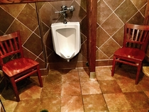 An awkward waiting area in the mens room