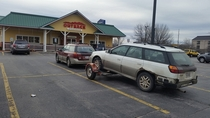 An Outback pulling an Outback stopped to eat at Outback parked outback