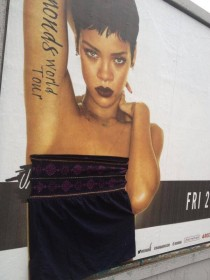 Apparently someone is going around Dublin and stapling clothes to scantily-clad Rihanna