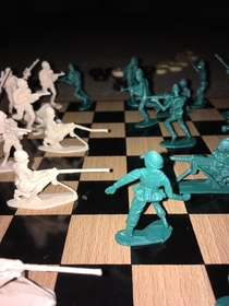 Army men chess with the son lol His idea