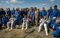 Astronauts who just landed from the ISS look like theyre just chillin in a middle of nowhere with their gang behind them