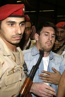 Barcelona superstar Lionel Messi arrives in Saudi Arabia for a promotional event His face is priceless as security escorts him through a crowd of fans