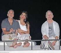 Bill Murray wearing a George Clooney Is A Beautiful Man shirt while watching fireworks with George Clooney