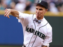 Bill Nye throwing the first pitch in his jerseybow tie combo