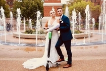 Bride and groom take a photo with the scooter that is the culprit for the brides cast She broke her arm in three places at the rehearsal dinner messing around Find the humor in everything I guess