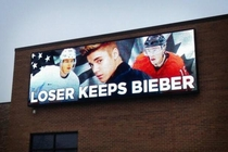 Canada VS USA hockey game tomorrow This is a billboard in Chicago