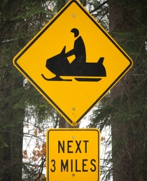 Caution Pac-Man driving snowmobile next  miles