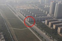 China Accidentally Builds Building In the Middle of Highway Decides To Leave It