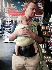 Christmas shopping with the family My wife asked if the baby carrier was maybe cutting off my sons circulation