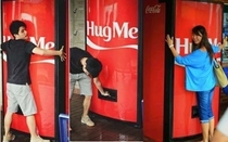Coca-Cola has created a vending machine which gives out free cans of Coke in return for hugs