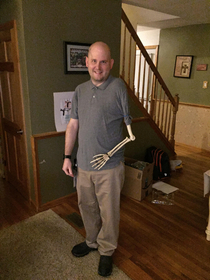 Confusing trick-or-treaters with a posable skeleton arm for the last  years