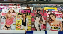 Contagious epidemic of itchy scalp in womens magazine aisle