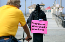 Counter protestor at Huntington Beach CA dressed up as a grim reaper