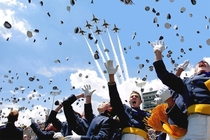 defenseless graduates flee as planes bombard the stadium with hats