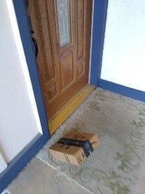 Delivery driver took my package delivered picture midway through tossing my package on the ground