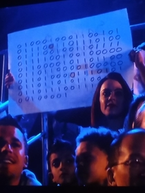 Destroy All Humans written in Binary on a sign at BattleBots